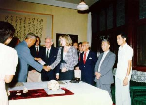 Mrs. Sackler presents first payment to President Ding Shisun in September, 1986